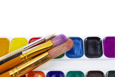 Bright paints watercolors with brushes isolated on white Stock Image