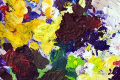 Bright palette of artist, texture of mixed oil paints in different colors, contrasting mix stains, splashes, texture for Stock Images
