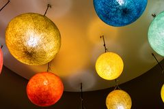 Bright paper lamps high orange blue yellow style asia eco lamps colorful interior giving style royalty free stock image
