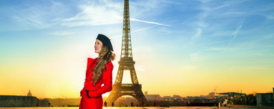 Happy tourist woman against Eiffel tower in Paris, France Royalty Free Stock Photos