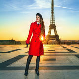 Traveller woman against Eiffel tower looking into distance Stock Images