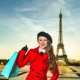 Traveller woman against Eiffel tower in Paris with shopping bag Stock Image