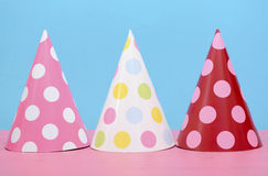 Bright party polka dot party hats. Royalty Free Stock Photos