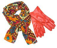 Bright patterned scarf and orange gloves Royalty Free Stock Image