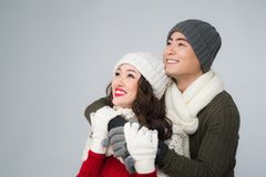 Bright picture of asian family couple in a winter clothes Royalty Free Stock Photos