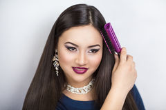 Bright Picture of Beautiful Woman with Comb Royalty Free Stock Photos