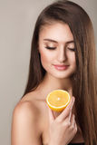 Bright picture of beautiful woman with lemon slice Stock Photo