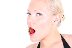 Bright picture of blonde with strawberry Royalty Free Stock Image