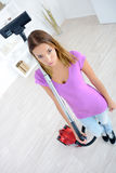 Bright picture bored housewife with vacuum cleaner Stock Photography