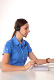 Bright picture of friendly female helpline operator Stock Photography