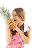 Bright picture of girl with pineapple. Isolated on white Royalty Free Stock Photography