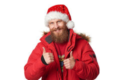 Bright picture of handsome man in christmas hat. Royalty Free Stock Photos