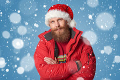 Bright picture of handsome man in christmas hat. Royalty Free Stock Photo