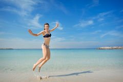 Bright picture of happy jumping woman on the beach.  Royalty Free Stock Photo