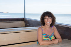 Bright picture of happy smiling woman on the ocean Royalty Free Stock Photography
