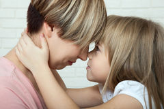 Bright picture of hugging mother and daughter, mothers Day Royalty Free Stock Photo