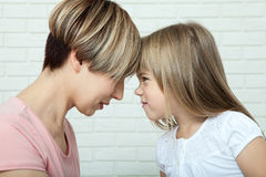 Bright picture of hugging mother and daughter, mothers Day Stock Image