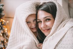 Bright picture of hugging mother and daughter in the shape of a heart stock photography