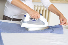 Bright picture of lovely housewife with iron Royalty Free Stock Images
