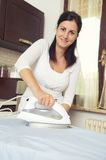 Bright picture of lovely housewife with iron Stock Image