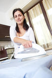 Bright picture of lovely housewife with iron Stock Photo