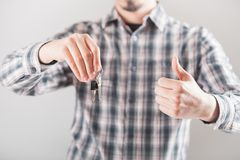 House key in hand. Bright picture of man hand holding house keys. Holding a thumb up Stock Photos