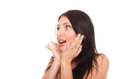 Bright picture of pretty woman astonished with hands over mouth royalty free stock photo