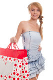 Bright picture smiling teenager with shopping bags Stock Images