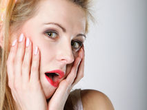 Bright picture of surprised woman face over gray Royalty Free Stock Images