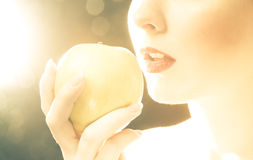 Bright picture of woman's lips with an apple Stock Images