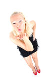 Bright picture of young blonde sending an air kiss Stock Image