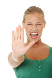 Bright picture of young woman making stop gesture. Royalty Free Stock Images