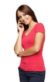 Bright picture of young woman talking on cellphone Royalty Free Stock Photo