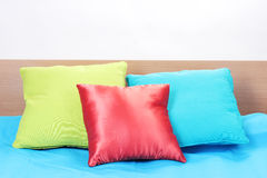 Bright pillows on bed Stock Photo