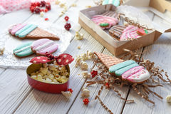 A bright pin up style photo with cookies in shape of ice-cream cones, macarons and cupcakes Stock Photography