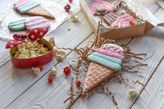 A bright pin up style photo with cookies in shape of ice-cream cones, macarons and cupcakes Royalty Free Stock Photo