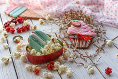 A bright pin up style photo with cookies in shape of ice-cream cones, macarons and cupcakes Stock Photos