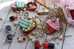 A bright pin up style photo with cookies in shape of ice-cream cones, macarons and cupcakes Stock Images