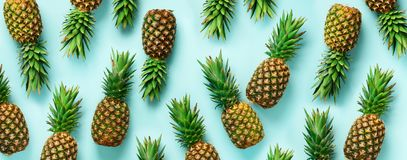Bright pineapple pattern for minimal style. Top View. Pop art design, creative concept. Copy Space. Banner. Fresh. Pineapples on blue background stock photos