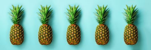 Bright pineapple pattern for minimal style. Top View. Pop art design, creative concept. Copy Space. Fresh pineapples on Stock Photography