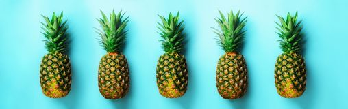 Bright pineapple pattern for minimal style. Top View. Pop art design, creative concept. Copy Space. Fresh pineapples on Stock Images