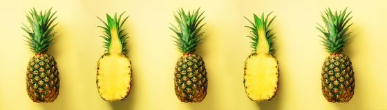 Bright pineapple pattern for minimal style. Top View. Pop art design, creative concept. Copy Space. Fresh pineapples on Royalty Free Stock Photo