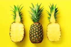 Bright pineapple pattern for minimal style. Top View. Pop art design, creative concept. Copy Space. Fresh pineapples on. Yellow background royalty free stock image