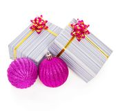 Bright pink christmas balls and gift boxes Stock Photos