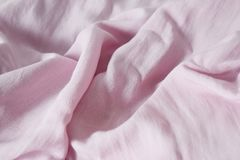 Bright pink cotton fabric and has a soft ripple , Top view with copy space. Royalty Free Stock Photo