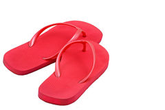 Bright Pink Flip Flops. A pair of bright pink flip flop sandals, photographed on a white background, ready for summer fun Royalty Free Stock Images