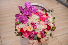 Bright pink flower bouquet in round box with lid. Big bright pink flower bouquet in round box with lid Royalty Free Stock Photo