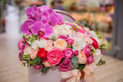 Bright pink flower bouquet in round box with lid. Big bright pink flower bouquet in round box with lid Royalty Free Stock Photos