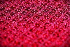 Bright pink fuchsia glitter squares sequin fabric background Royalty Free Stock Photo
