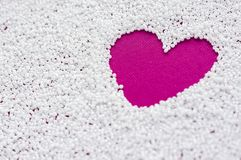 Bright pink heart on white beads Royalty Free Stock Photography